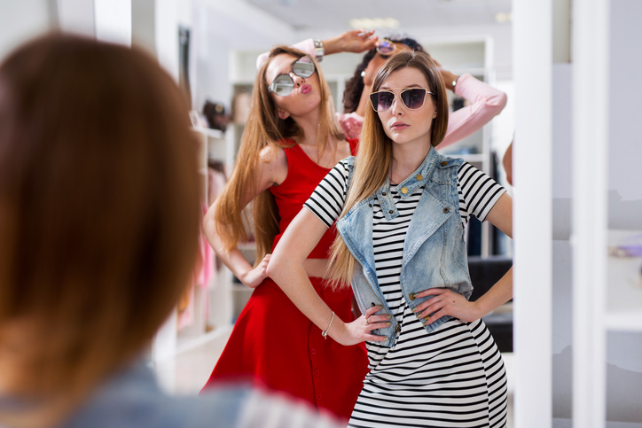 Glamorous Girls Trying On Sunglasses Posing In Front Of The Mirror